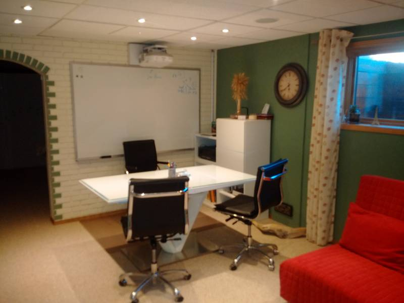 Private classroom with smartboard and computers.